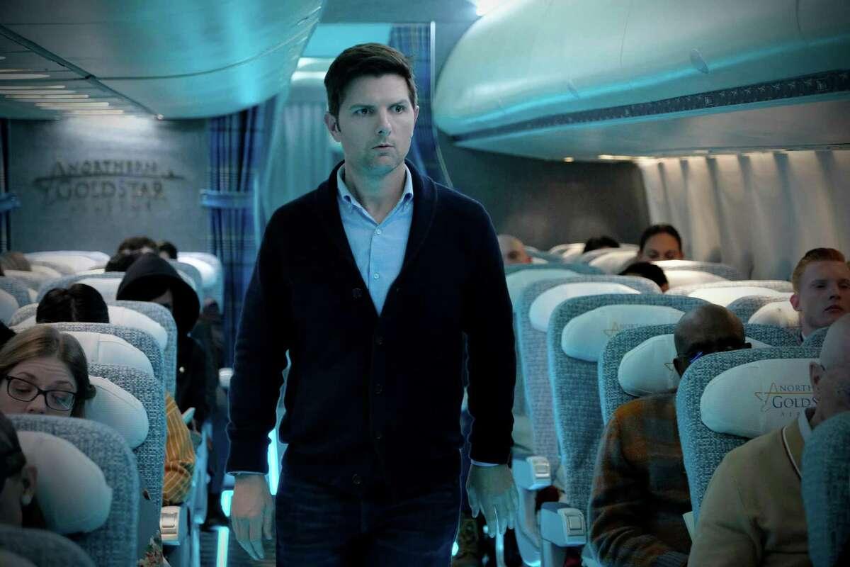 "Adam Scott plays Justin Sanderson in the ""Nightmare at 30,000 Feet"" episode of ""The Twilight Zone."" MUST CREDIT: Robert Falconer, CBS"