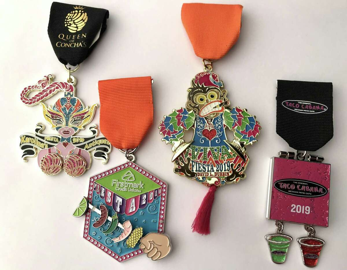 Click ahead to view the best San Antonio Fiesta medals 2019 had to offer. Fiesta Medals Contest top winners, left to right: Queen of Conchas by Karolina's Antiques (Best in Show Overall and First Place: Retailers); Firstmark Credit Union (First Runner-up Overall and First Place: Food treats); Monkey toy medal by David Durbin (Second Runner-up Overall tie and First Place: Individual); Taco Cabana (Second Runner-up Overall tie and First Place: Restaurants).