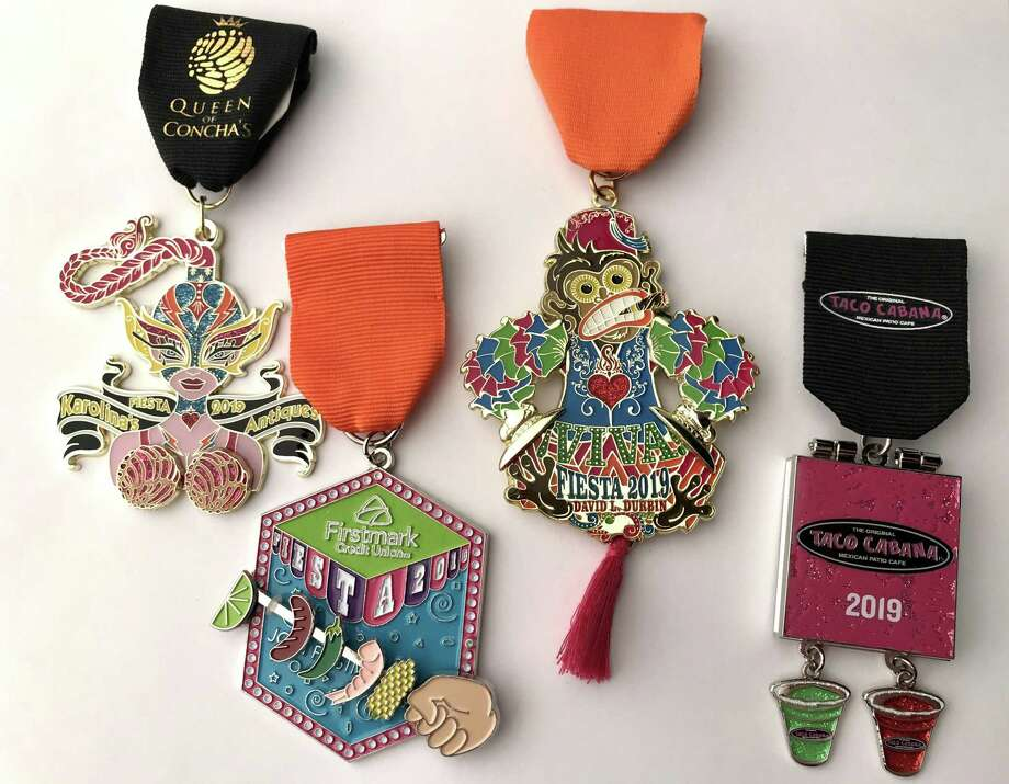 Fiesta Medals Contest top winners, left to right: Queen of Conchas by Karolina's Antiques (Best in Show Overall and First Place: Retailers); Firstmark Credit Union (First Runner-up Overall and First Place: Food treats); Monkey toy medal by David Durbin (Second Runner-up Overall tie and First Place: Individual); Taco Cabana (Second Runner-up Overall tie and First Place: Restaurants). Photo: René A. Guzman /Staff