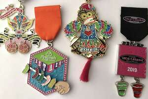 Fiesta Medals Contest top winners, left to right: Queen of Conchas by Karolina's Antiques (Best in Show Overall and First Place: Retailers); Firstmark Credit Union (First Runner-up Overall and First Place: Food treats); Monkey toy medal by David Durbin (Second Runner-up Overall tie and First Place: Individual); Taco Cabana (Second Runner-up Overall tie and First Place: Restaurants).