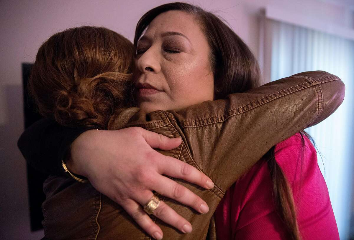 Aisha McCain (right) hugs her business partner Dr. Annemarie Sheets as she leaves her home in the East Bay Area Wednesday, March 13, 2019.