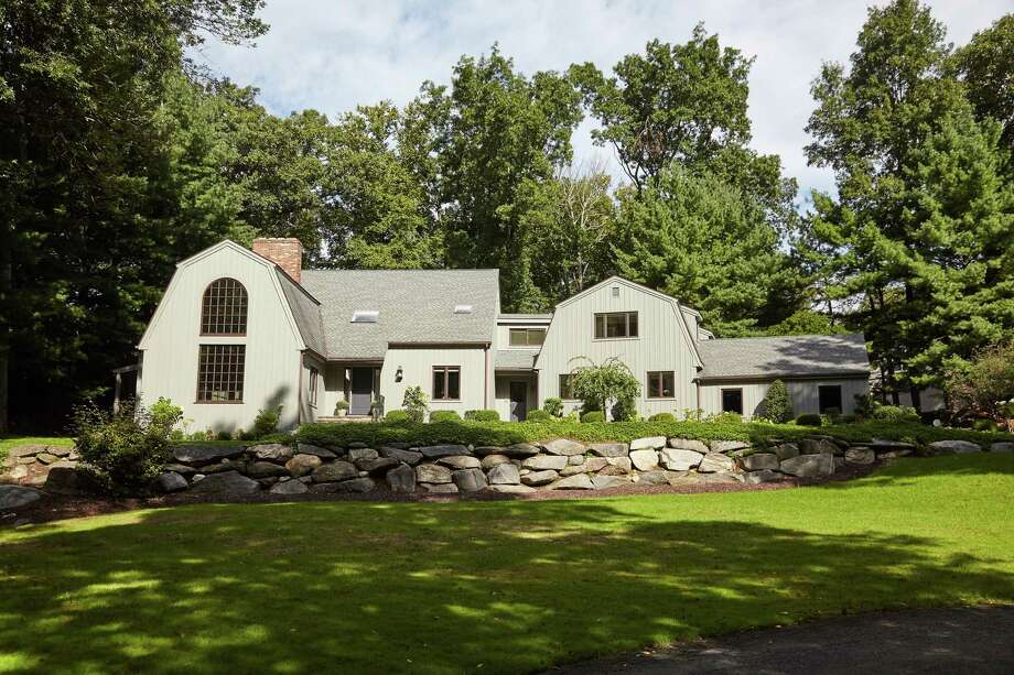 The recently updated home at 41 Merriebrook Lane in Stamford is on 2.5 acres. The home is near the 400-acre Mianus River Park, which offers numerous hiking and biking trails. Photo: Halstead Connecticut / ONLINE_CHECK