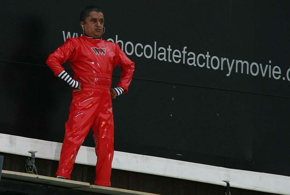 """Actor Deep Roy who plays an Oompa Loompa in """"Charlie and the Chocolate Factory"""" dances on the movie billboard ahead of the 2005 movie release. The play will be performed at UH- Clear Lake on several days this month"""