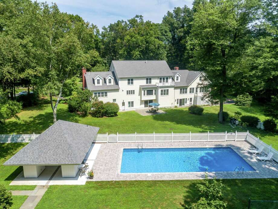 The heated pool, cabana, fencing, decking and Har Tru clay tennis court at 10 Snowberry Lane in New Canaan were all renovated in 2017. Photo: Halstead Connecticut