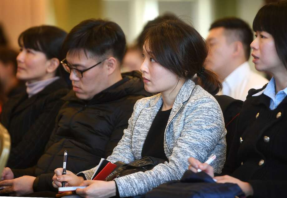 Students from Soochow University in Taiwan attend a lecture on blockchain and cryptocurrency at the Ancell School of Business at Western Connecticut State University on Monday. Photo: Brian A. Pounds / Hearst Connecticut Media / Connecticut Post