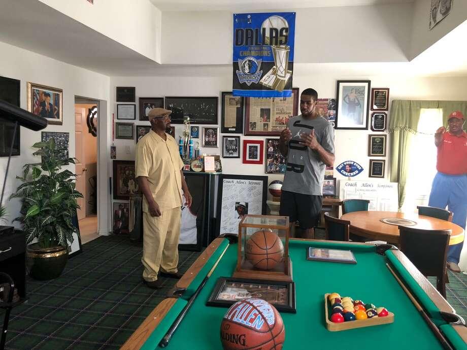 "LaMarcus Aldridge with his former coach, Robert Allen, on the TV series ""Superstar Renovation."" Photo: Tom Orsborn/Staff"