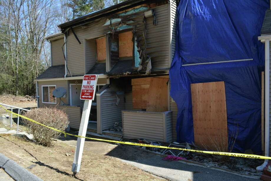 Jake Butler, 20 was arrested on April 16 for first-degree arson and other charges for allegedly starting a fire that heavily damaged his neighbor's apartment, on right, at the Woodland Hills apartment complex. Photo: Leslie Hutchison / Hearst Connecticut Media /