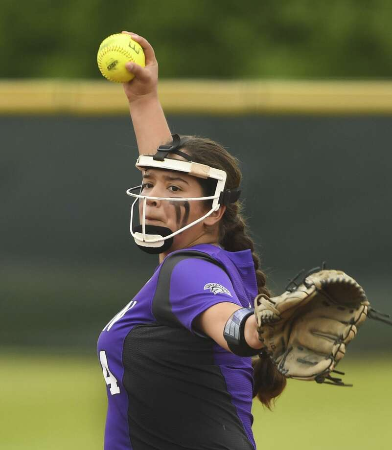 Warren pitcher Annika Literrio allowed one hit and struck out 11 in a complete-game win over Holmes. Photo: Billy Calzada / Staff Photographer / San Antonio Express-News