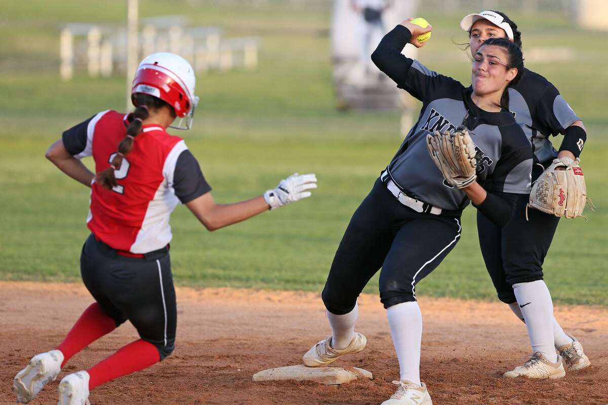 Steele's Lauren Anderson tries for a double play after forcing out Judson's Kaili Luna, left, at second base during the second inning of their District 26-6A high school softball game at Steele on Friday, . Judson won the game 7-4.