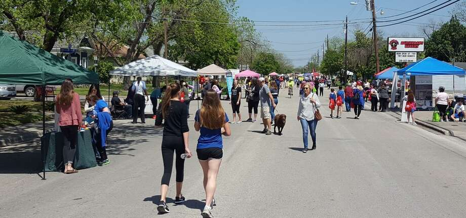 Booths dot the landscape as walkers, riders, skaters and four-legged friends are busy Movin' On Main in the inaugural Schertz event April 8. Photo: Jeff B. Flinn /Staff File Photo