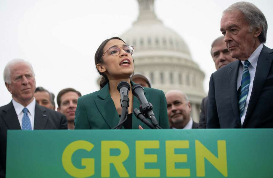 Rep. Alexandria Ocasio-Cortez speaks during a press conference to announce Green New Deal legislation to promote clean energy programs outside the Capitol in February. The freshman representative is challenging elites. Photo: SAUL LOEB /AFP /Getty Images / AFP or licensors