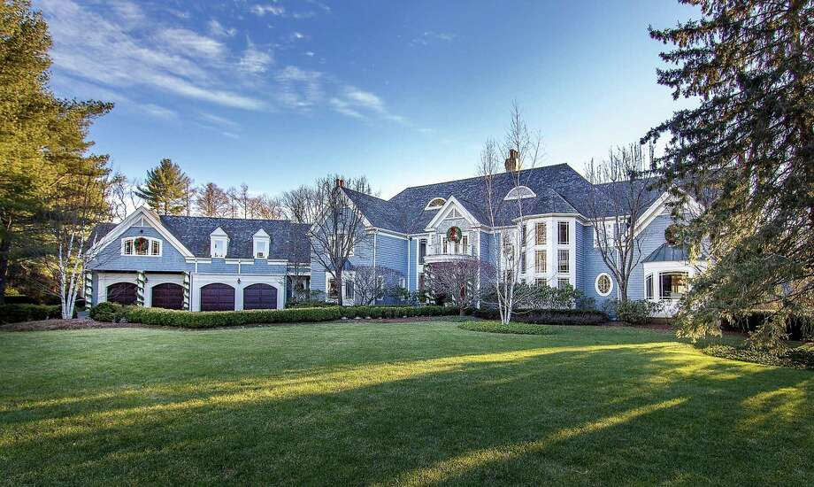 The gated estate at 7 Spruce Meadow Court in Wilton is on 2.36 beautifully manicured acres. Photo: Vanderblue Team / ONLINE_CHECK