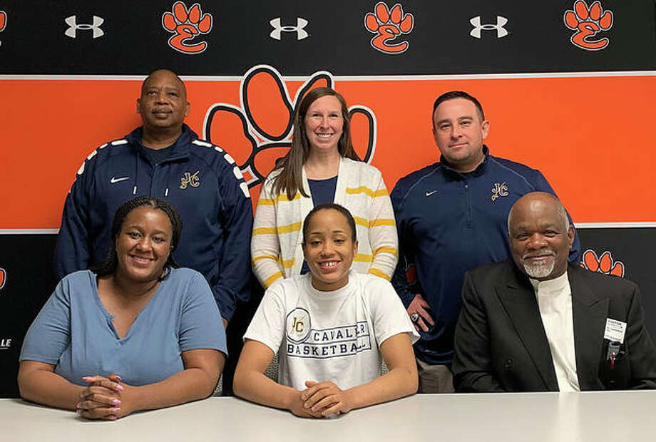 EHS senior Jaylen Townsend, seated center, will play women's basketball for Johnson County Community College in Kansas. She is joined by her family and EHS assistant coach Katie Bevis O'Neal. Photo: Matt Kamp/The Intelligencer