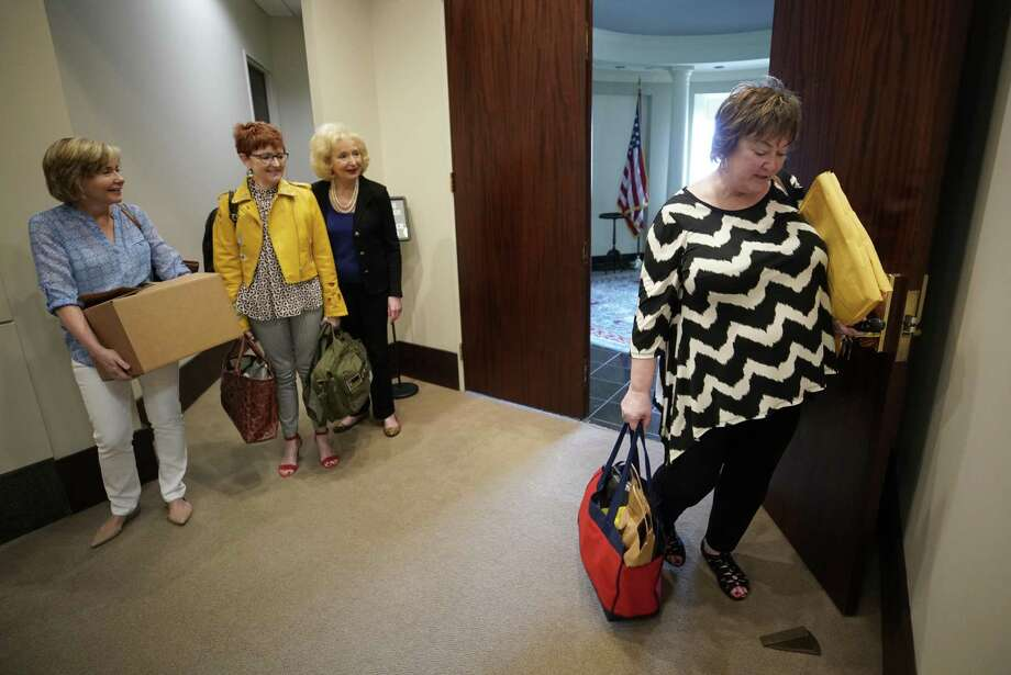 Nancy Lisenby, chief of staff assistant, left, Laura Cather Pears, director of scheduling, and Mary Sage, office manager, wait as Jean Becker, chief of staff, right, closes the door to the George H.W. Bush office on Memorial Drive Friday, March 29, 2019, in Houston. The staff closed the office for the last time on Friday. The George and Barbara Bush Foundation will occupy part of the office space. Photo: Melissa Phillip,  Houston Chronicle / Staff Photographer / © 2019 Houston Chronicle