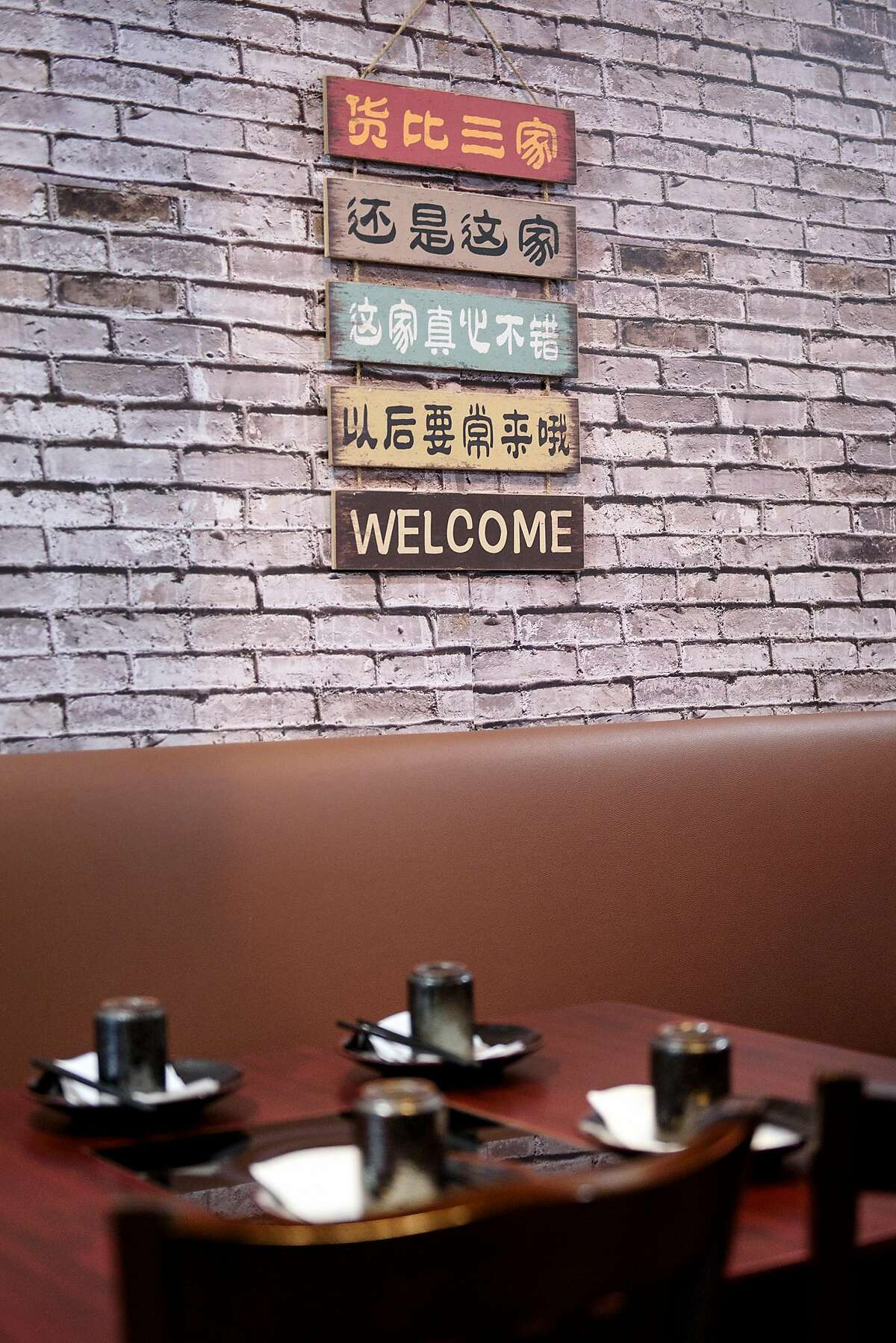 A welcome sign hangs on the wall at Woija Hunan Cuisine in Albany, Calif., on Thursday March 28, 2019.