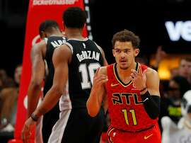 ATLANTA, GEORGIA - MARCH 06:  Trae Young #11 of the Atlanta Hawks reacts after a basket against the San Antonio Spurs in the second half at State Farm Arena on March 06, 2019 in Atlanta, Georgia.  NOTE TO USER: User expressly acknowledges and agrees that, by downloading and or using this photograph, User is consenting to the terms and conditions of the Getty Images License Agreement.  (Photo by Kevin C.  Cox/Getty Images)