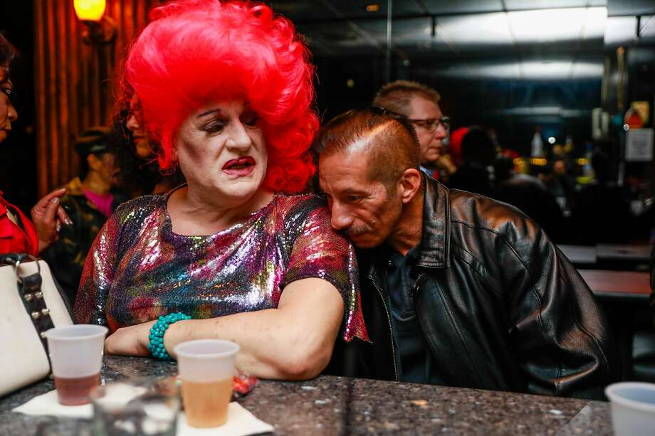 Joseph Castenada rests his head on Collette Le Grand (left) at Divas bar in San Francisco, California, on Saturday, March 30, 2019. Divas, the Tenderloin's three story bar devoted to transgender women celebrated it's final night on Saturday. Photo: Gabrielle Lurie / The Chronicle