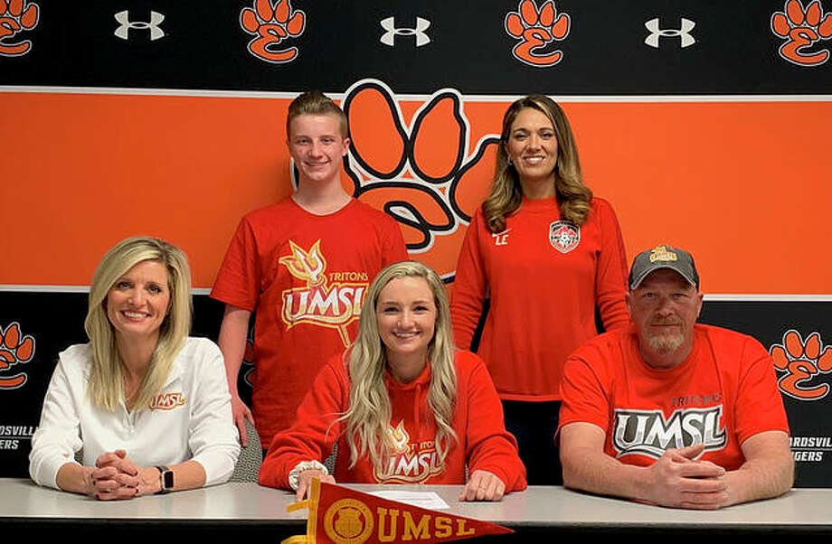 Edwardsville senior Emma Sitton, seated center, will play women's soccer at UMSL. She is joined by her family. Photo: Matt Kamp/The Intelligencer