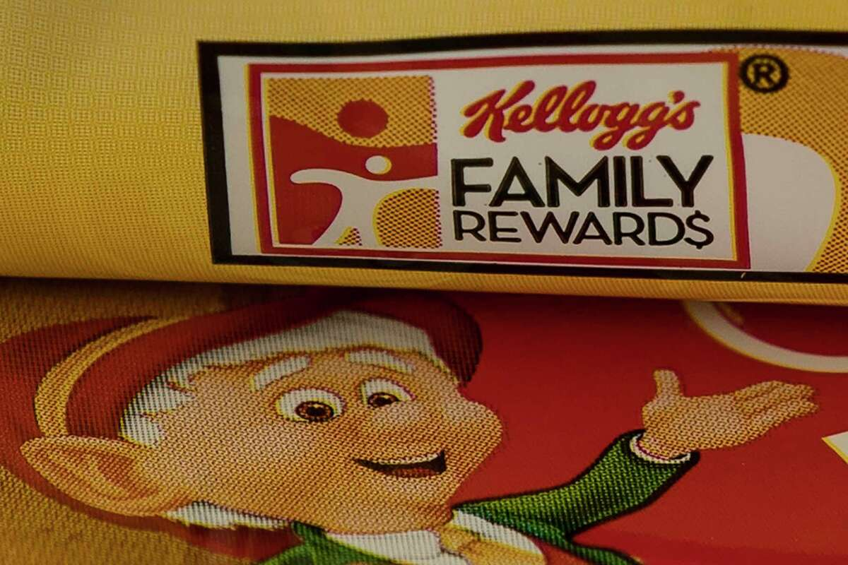 This photo shows the packaging of containers of Keebler cookies in Glenside, Pa., Monday, April 1, 2019. Kellogg is selling its iconic Keebler cookie brand and other sweet snacks businesses to Ferrero for $1.3 billion. Kellogg is also selling its Mother's and Famous Amos cookie brands, as well as its fruit-flavored snack, pie crust and ice cream cone businesses. (AP Photo/Matt Rourke)