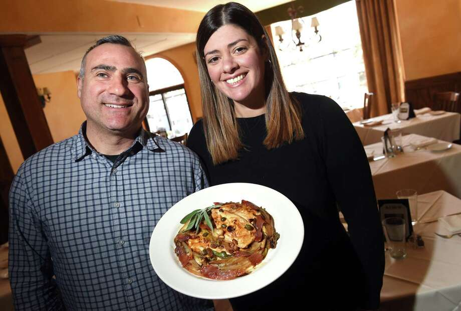Francesco d'Amuri and his wife, Alison De Renzi, co-owners of L'Orcio restaurant in New Haven, are photographed with Pollo alla Perugina March 27, 2019. Photo: Arnold Gold / Hearst Connecticut Media / New Haven Register