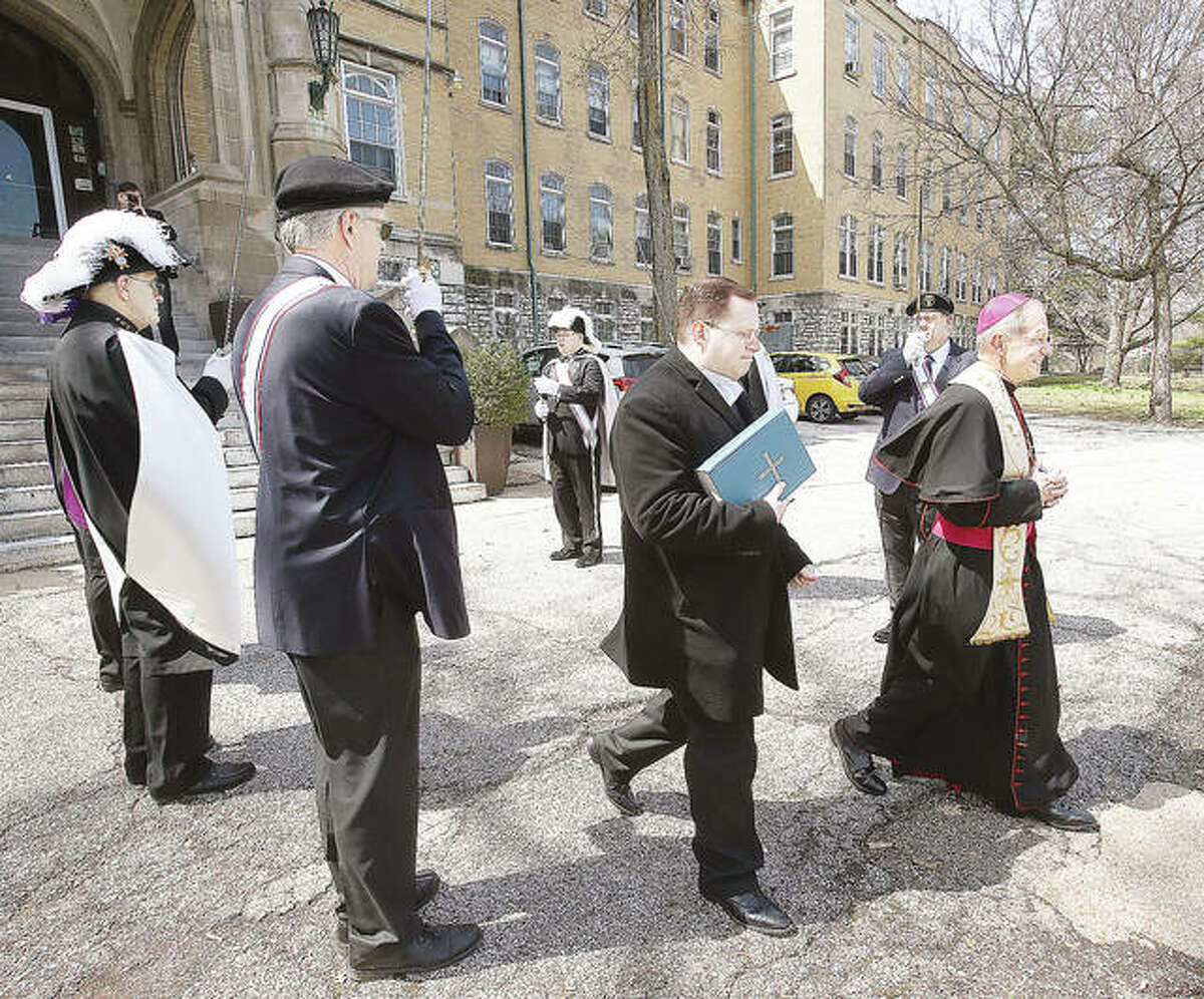 The Rev. Thomas John Paprocki walks through an honor guard from the 4th Degree Knights of Columbus Monday on his way to bless the new statue of Our Lady of Fatima at the Catholic Children's Home in Alton.