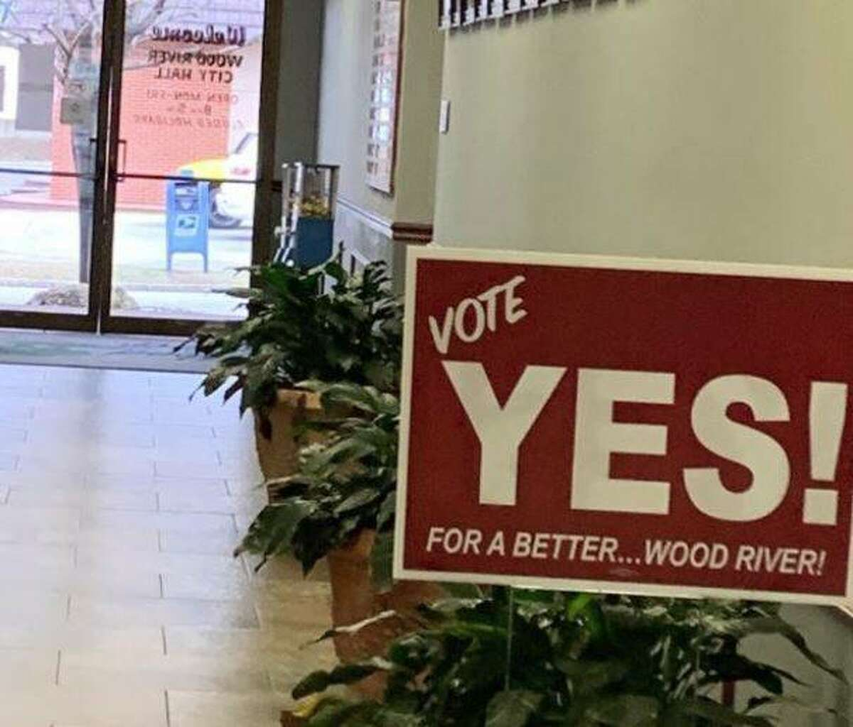 """A """"Vote Yes!"""" sign is seen placed inside Wood River City Hall."""