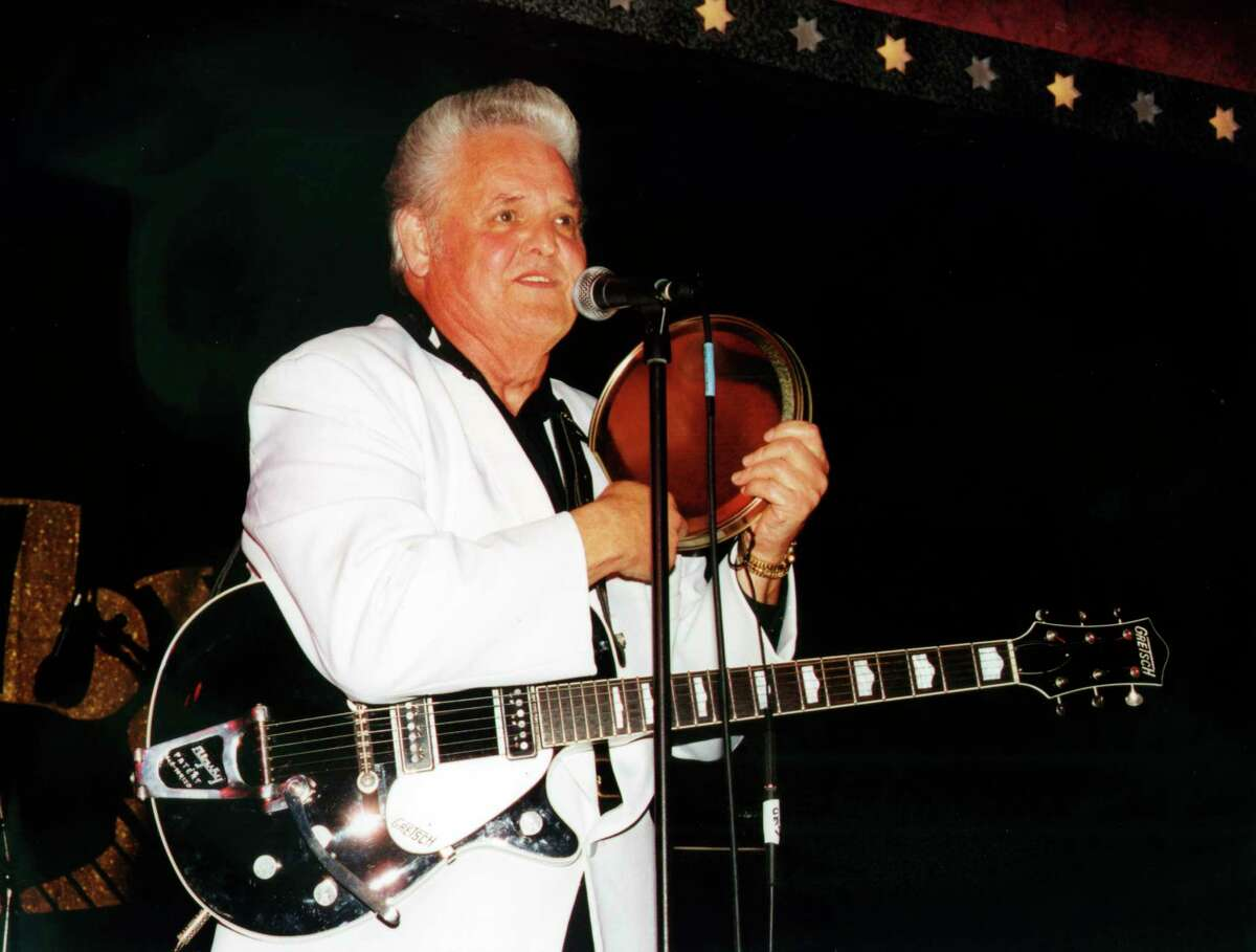 This 2002 photo released by Redbush Classics Records shows rockabilly Hall of Famer Billy Adams performing in Hemsby, England. Adams, who wrote and recorded a rockabilly staple ?Rock, Pretty Mama,? died Saturday, March 30, 2019, in Westmoreland, Tenn. He was 79. (Redbush Classics Records via AP)