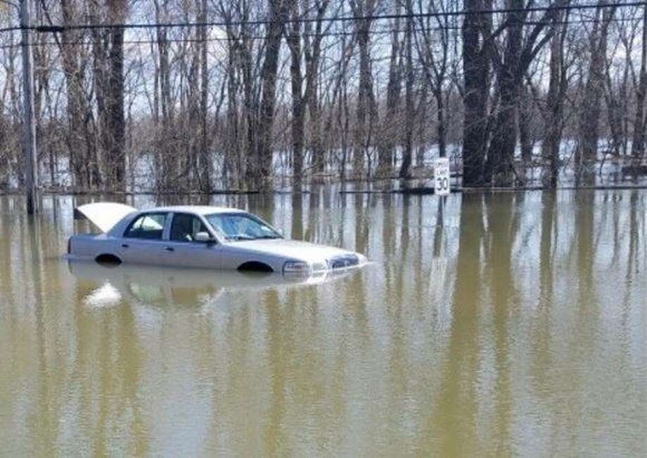 Pictured it the vehicle still partially submerged following the rescue. The height of the water in places, on the way to the vehicle, is up to chest deep.
