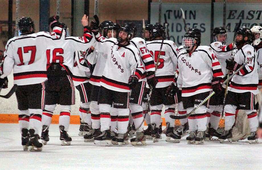 Members of the SIUE hockey team congratulate each other following a victory over Iowa State University at the East Alton Ice Arena. The Cougars lose just three seniors as they look forward to next season, which gets underway this weekend with the team's mini camp in East Alton. Photo: Ray Takmajian, SIUE Hockey | For The Telegraph