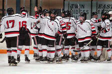 Members of the SIUE hockey team congratulate each other following a victory over Iowa State University at the East Alton Ice Arena. The Cougars lose just three seniors as they look forward to next season, which gets underway this weekend with the team's mini camp in East Alton.