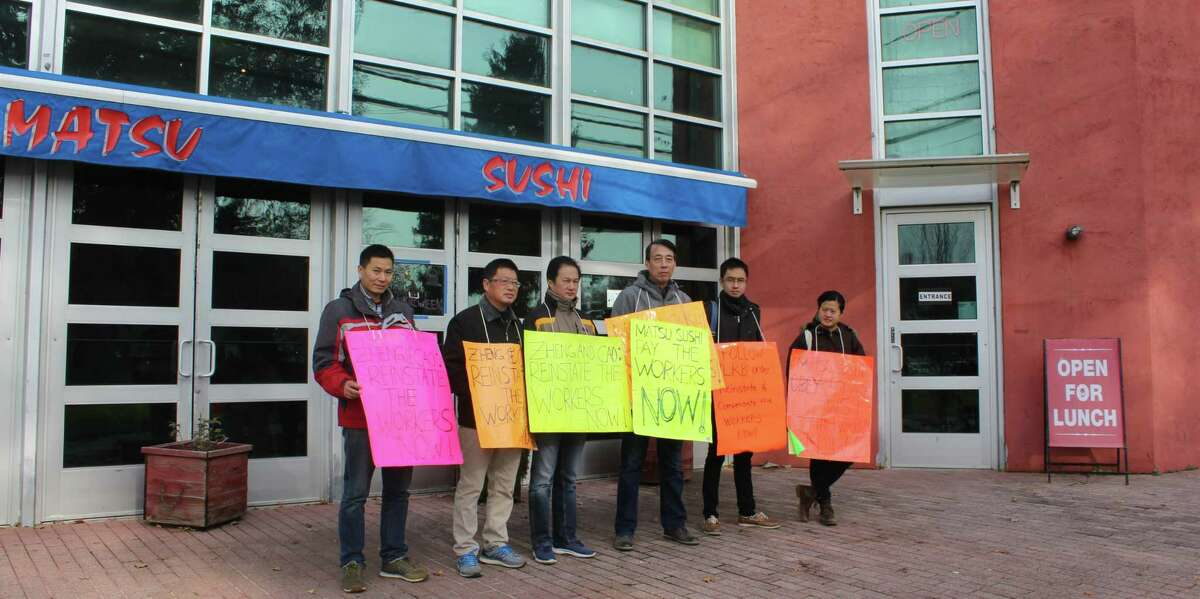 Former Matsu Sushi employees picket outside the restaurant on Nov. 19 in protest of Matsu's labor practices.