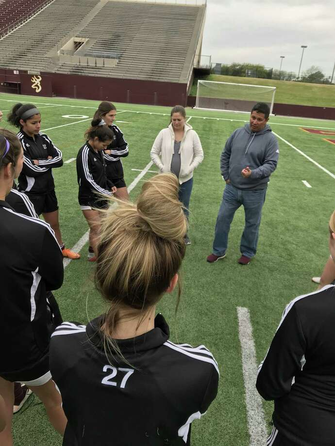 Lady Deer head coach Jesse Saavedra goes over last-minute instructions with the club, following Monday's practice at Abshier Stadium. Photo: Robert Avery