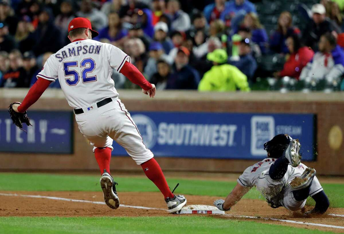 Texas Rangers relief pitcher Adrian Sampson (52) touches the bag ahead of Houston Astros' Jake Marisnick (6) for the out in the sixth inning of a baseball game in Arlington, Texas, Monday, April 1, 2019. (AP Photo/Tony Gutierrez)