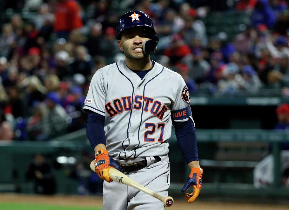 Houston Astros' Jose Altuve (27) walks to the dugout after striking out against pitches from Texas Rangers relief pitcher Adrian Sampson in the fifth inning of a baseball game in Arlington, Texas, Monday, April 1, 2019. (AP Photo/Tony Gutierrez)