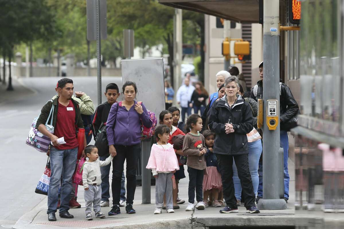 Central American immigrants are led from the Greyhound Bus depot to the City of San Antonio Resource Center, Monday, April 1, 2019. The center provides food and shelter for immigrants waiting to board buses to their final destination. The center is located on city-owned property across the street from the Greyhound Bus depot. It opened Saturday evening in response to an increase of immigrants dropped off at the depot by Department of Homeland Security. According to Assistant City Manager Colleen Bridger, the center has processed between 75-100 immigrants daily and is opened from 6 a.m. to 10 p.m.