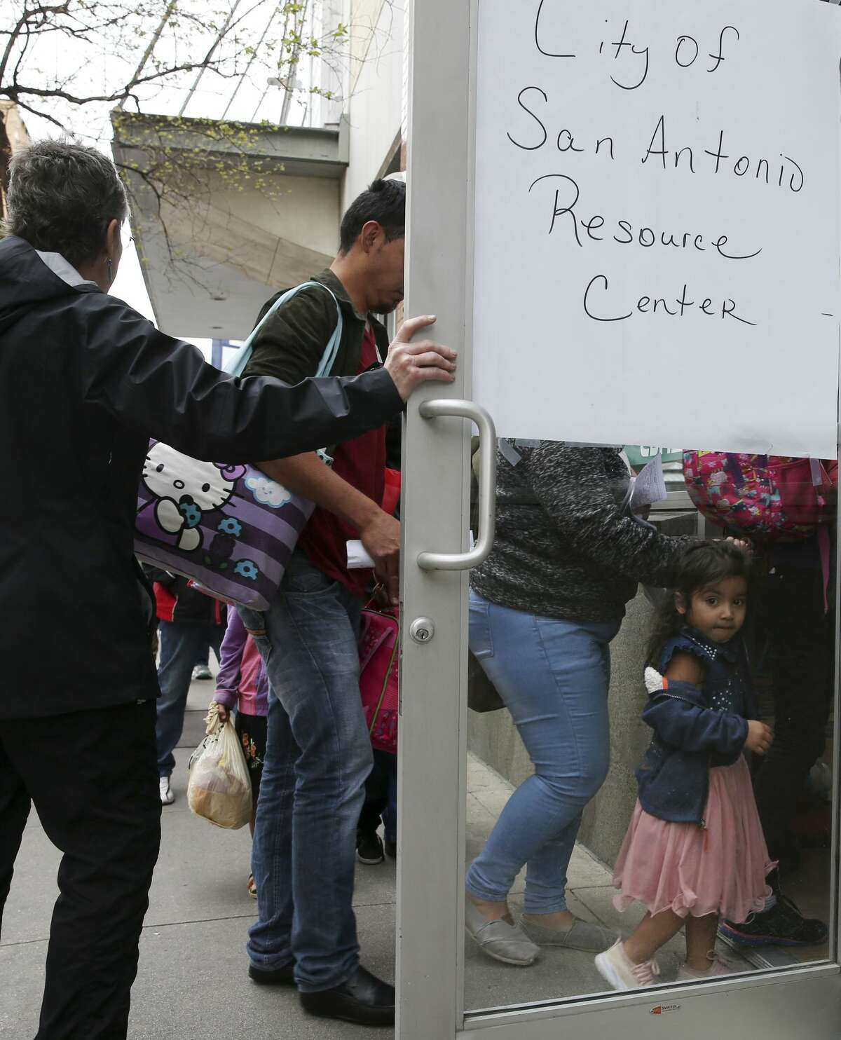 Central American immigrants are led into the City of San Antonio Resource Center from the Greyhound Bus, Monday, April 1, 2019. The center provides food and shelter for immigrants waiting to board buses to their final destination. The center is located on city-owned property across the street from the Greyhound Bus depot. It opened Saturday evening in response to an increase of immigrants dropped off at the depot by Department of Homeland Security. According to Assistant City Manager Colleen Bridger, the center has processed between 75-100 immigrants daily and is opened from 6 a.m. to 10 p.m.