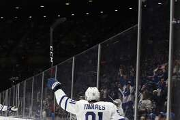 UNIONDALE, NEW YORK - APRIL 01: John Tavares #91 of the Toronto Maple Leafs scores the game winning goal against the New York Islanders as 3:50 of the third period at NYCB Live's Nassau Coliseum on April 01, 2019 in Uniondale, New York. The Maple Leafs defeated the Islanders 2-1. (Photo by Bruce Bennett/Getty Images)