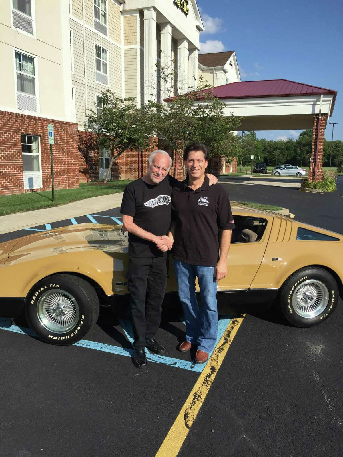 Rick Barone poses with Malcolm Bricklin in front of his 1974 Bricklin SV1 4 speed, believed to be one of only three in existence.