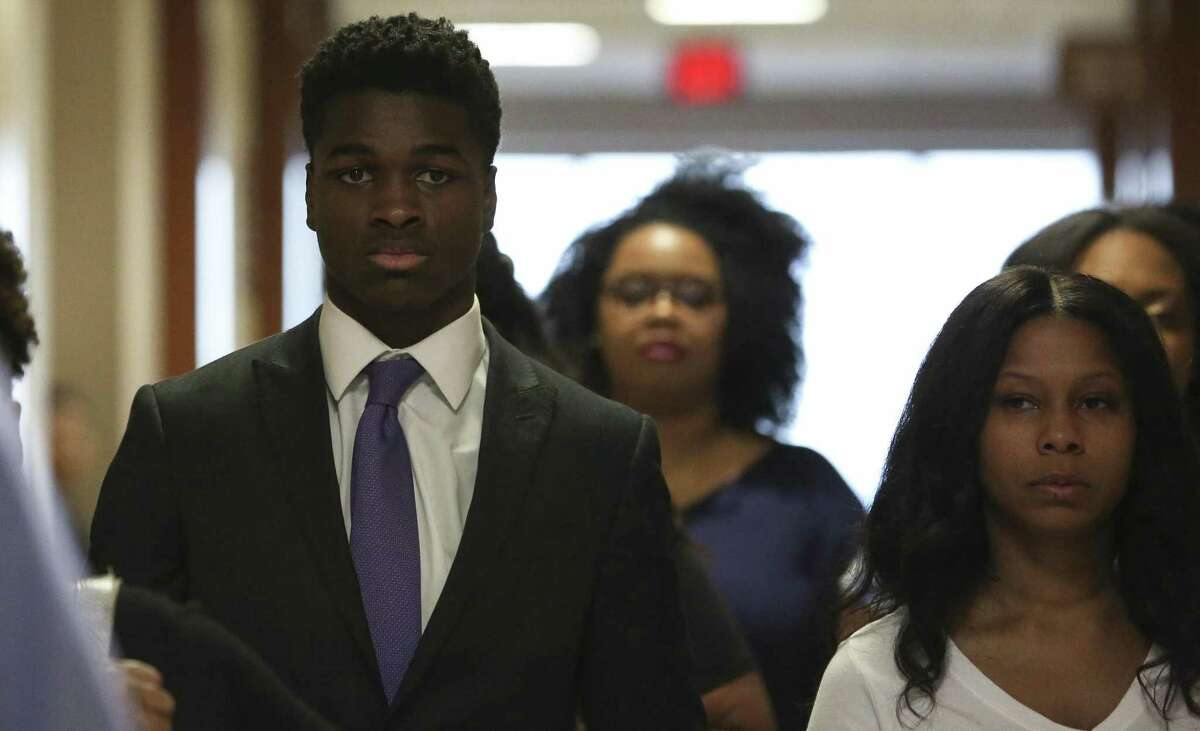 Antonio Armstrong Jr., the juvenile accused of gunning down his parents while they slept, arrives at court with family and supporters for a hearing at Harris County Criminal Justice Center on Monday, Sept. 17, 2018, in Houston.