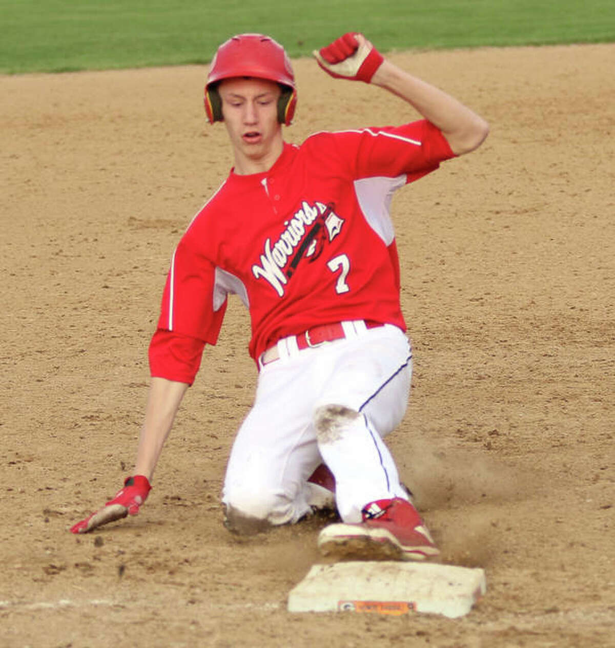 Calhoun's Corey Nelson slides safely into third base during the Warriors' six-run fifth inning Monday in Gillespie.