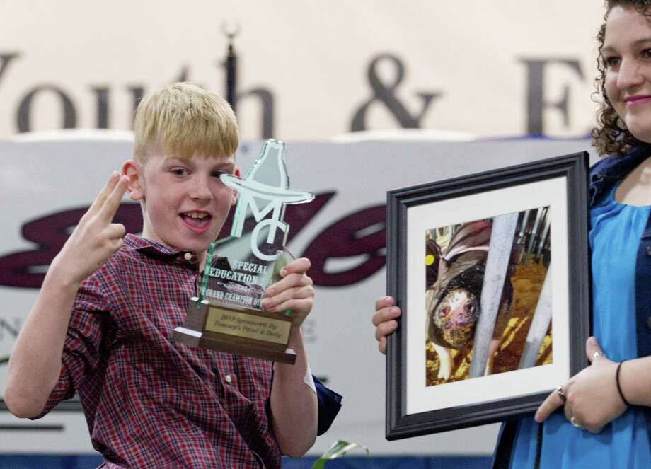 Cooper Jones, of Magnolia, reacts after his photography won Division I grand champion during the annual Sunshine Awards at the Montgomery County Fair and Rodeo, Monday, April 1, 2019, in Conroe. Photo: Jason Fochtman, Houston Chronicle / Staff Photographer / © 2019 Houston Chronicle