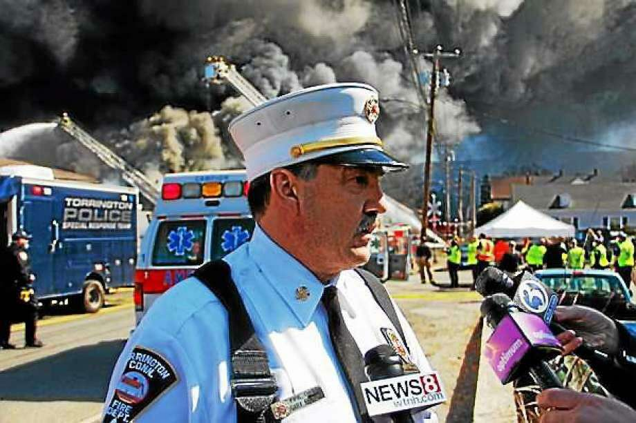 The Toce tire warehouse fire in April 2015 was a major event in Torrington that forced families to leave their homes and kept firefighters busy for the entire day. Above, then-Torrington Fire Chief Gary Brunoli, who has since retired, speaks to a reporter from the scene. Photo: File Photo / Hearst Connecticut Media /