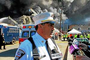 The Toce tire warehouse fire in April 2015 was a major event in Torrington that forced families to leave their homes and kept firefighters busy for the entire day. Above, then-Torrington Fire Chief Gary Brunoli, who has since retired, speaks to a reporter from the scene.