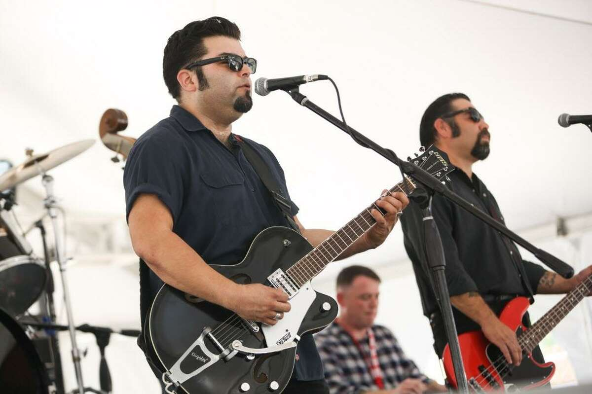 Nick Gaitan and The Umbrella Man performs during the Conroe Americana Music Festival on Sunday, May 7, 2017, in downtown Conroe.