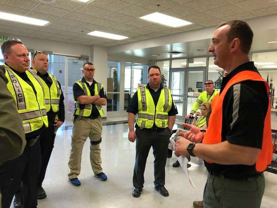 Sgt. Matthew Breihan, right, preps the police officers about details about the simulated active intruder training that took place March 22 across all District 7 school buildings. Photo: By Julia Biggs | The Intelligencer
