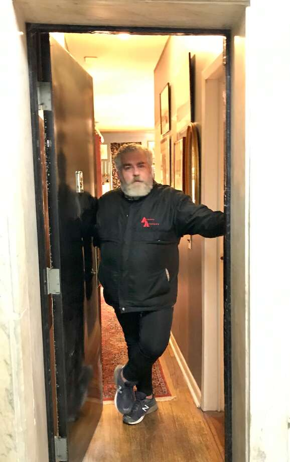 Theodore Bouloukos in the doorway of the elegant Upper East Side apartment of The Fabulous Bouloukos Boys of Albany Academy. (Paul Grondahl / Times Union) Photo: Paul Grondahl/Times Union