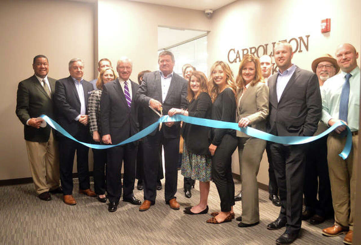 Carrollton Bank conducted a ribbon-cutting ceremony on Monday for its new Edwardsville location at 222 E. Park St., Suite 400, in the Madison Mutual Building.