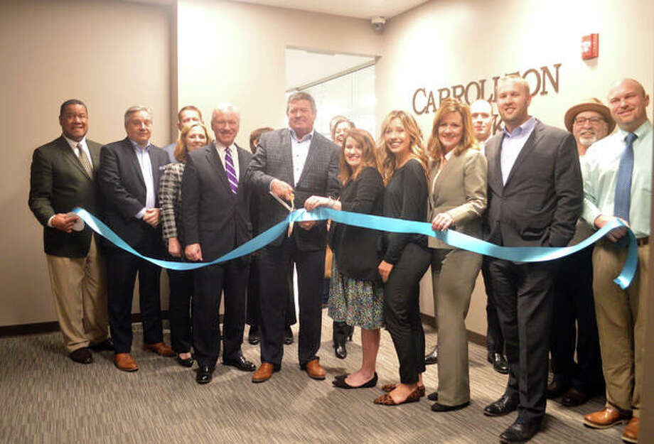 Carrollton Bank conducted a ribbon-cutting ceremony on Monday for its new Edwardsville location at 222 E. Park St., Suite 400, in the Madison Mutual Building.  Photo: Scott Marion | The Intelligencer