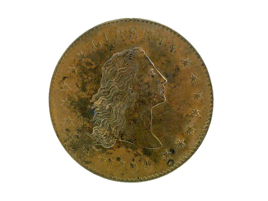 A copper $1 coin minted two years after the dollar was established. Photo: Jaclyn Nash, National Museum Of American History / This image was obtained from the Smithsonian Institution. The image or its contents may be protected by international copyright