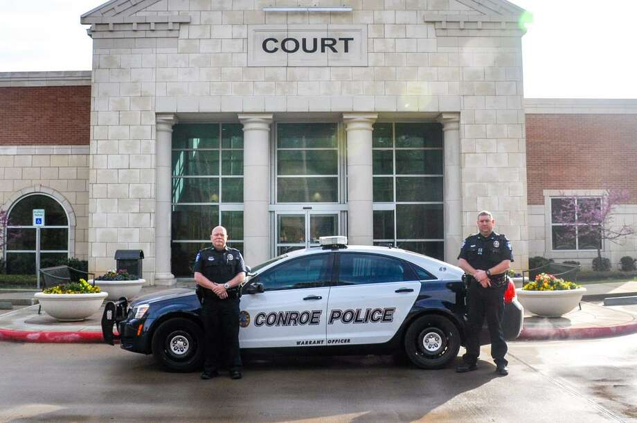 Conroe Municipal Court Warrant officers Jackie Everitt and Raymond McCreary with the assistance of the Conroe Police Department, coordinated a warrant roundup last year. Photo: Courtesy Photo